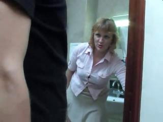 older  woman gets a piss on the toilet and takes