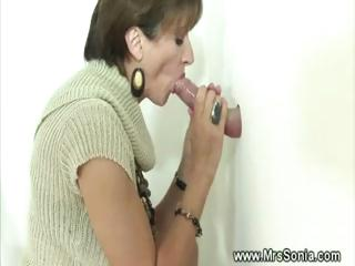 cuckold sees slutty woman licking gloryhole penis