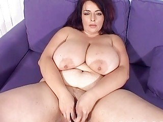 large boobed lady girl pleases on the bed